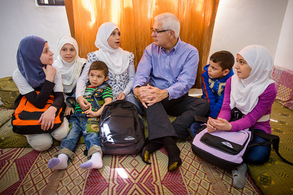 (RNS1-March24) World Vision's U.S. President Rich Stearns, center, visits with Syrian refugees in Irbid, Jordan. For use with RNS-WORLD-VISION, transmitted on March 24, 2014, Photo by Jon Warren, courtesy of World Vision.